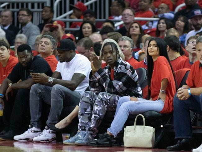 Travis Scott and Kylie Jenner courtside during Quarterfinals of 2017 NBA Playoffs, April 25, 2017 in Houston, Texas. Photo: Bob Levey/Getty Images.