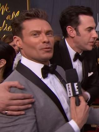 The face says it all ... Ryan Seacrest is clearly not a fan of Sacha Baron Cohen. Picture: E!