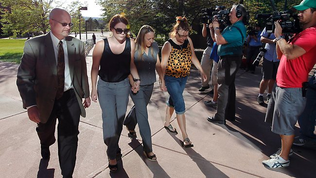 Family members of a victim fromthe shooting hold hands as they arrive for a court appearance by shooting suspect James Holmes at the Arapahoe County Courthouse. AP Photo/Alex Brandon