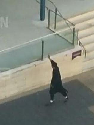The moment a teenager started firing a gun in front of Parramatta police station before being shot dead himself.