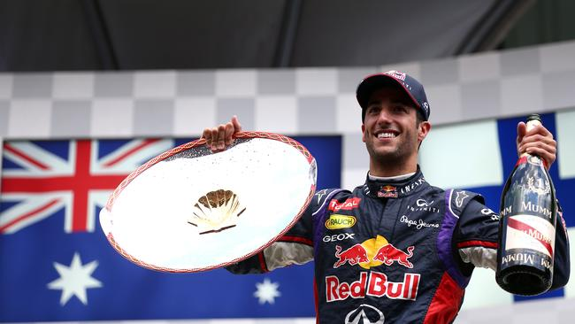 Daniel Ricciardo with the spoils of victory at Spa.