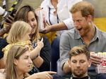 TORONTO, ON - SEPTEMBER 27: Prince Harry (R) sits with David Henson's wife Hayley Henson (L) and daugther Emily Henson at the Sitting Volleyball Finals during the Invictus Games 2017 at Mattamy Athletic Centre on September 27, 2017 in Toronto, Canada. (Photo by Chris Jackson/Getty Images for the Invictus Games Foundation)