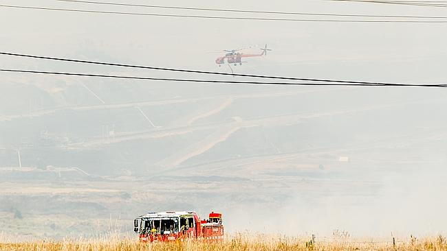 Sky crane Malcolm fights the fires at Morwell. Picture: Jason Edwards