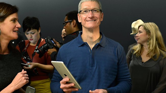 Apple CEO Tim Cook speaks displays the new iPad mini after it was unveiled during an Apple special event at the historic California Theater. Picture: Kevork Djansezian