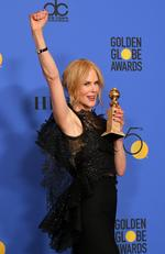 Nicole Kidman poses with the Best Performance by an Actress in a Limited Series or a Motion Picture Made for Television for 'Big Little Lies' in the press room during The 75th Annual Golden Globe Awards. Picture: AFP