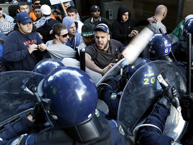 Protestors clash with police at the riot. Photo: Mitch Cameron