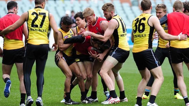 Power players get physical during training at Adelaide Oval. Picture: Mark Brake.