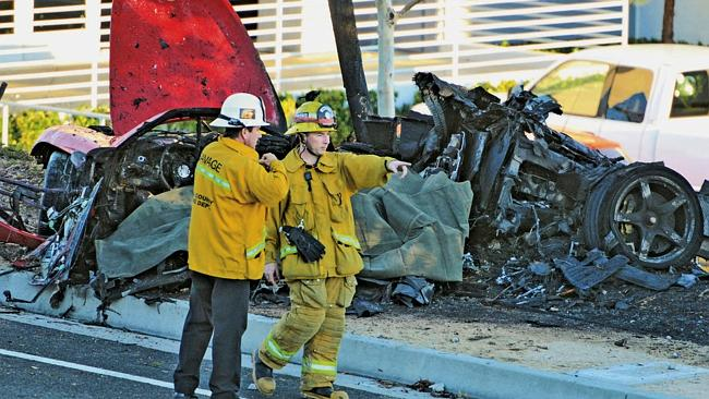 Carnage ... The wreckage of the Porsche that crashed into a light pole on Hercules Street near Kelly Johnson Parkway in Valencia, California. Picture: AP/The Santa Clarita Valley Signal, Dan Watson