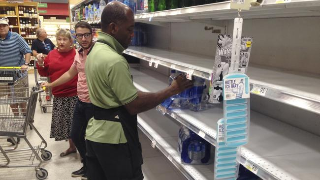 Supermarkets are rushing to restock shelves as residents stock up before the storm. Picture: Wilfredo Lee