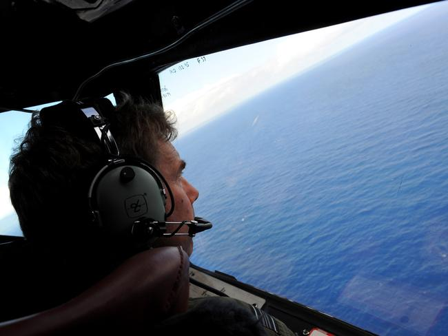 Extensive search ... co-pilot and Squadron Leader Brett McKenzie of the Royal New Zealand Airforce helps to look for objects, over the southern Indian Ocean on April 13, 2014. Picture: Greg Wood