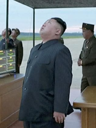 Kim Jong-un watches his latest missile launch over Japan. Picture: KRT via AP Video.