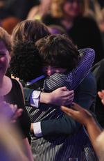 Caleb McLaughlin, Finn Wolfhard and Gaten Matarazzo of 'Stranger Things' embrace after winning Outstanding Performance by an Ensemble in a Drama Series onstage during The 23rd Annual Screen Actors Guild Awards. Picture: Getty