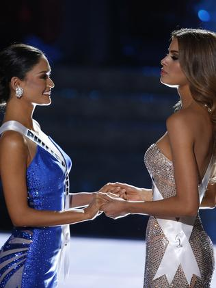 Miss Colombia and Miss Philippines wait for the announcement. Picture: AP