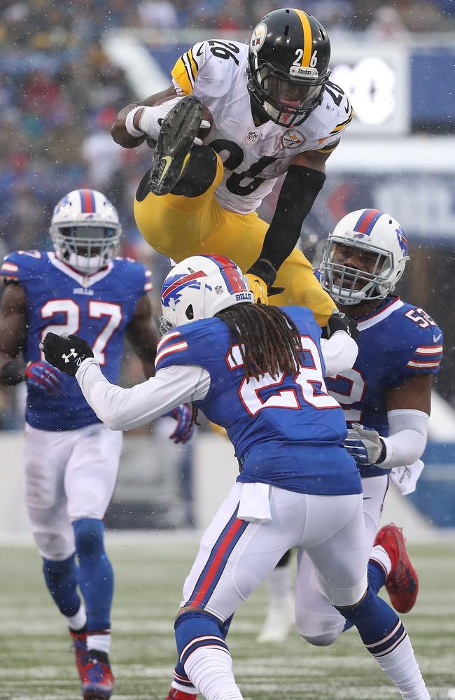 Le'Veon Bell #26 of the Pittsburgh Steelers jumps over Ronald Darby #28 of the Buffalo Bills.