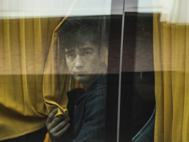 A young boy arrives on a coach. Picture: Dan Kitwood/Getty Images