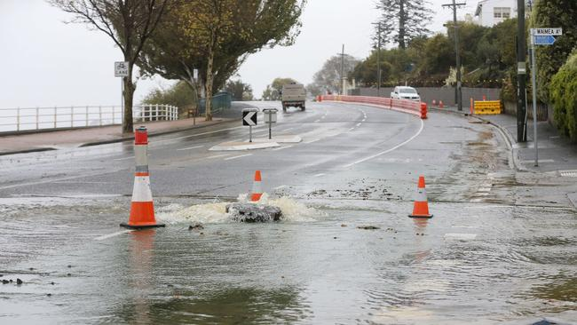 An overflowing sewage drain closed Sandy Bay Road south of Wrest Point. Picture: MATHEW FARRELL
