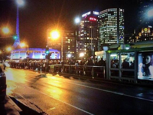 People queue for trams in Melbourne after a fire in Richmond stopped trains to the eastern suburbs.