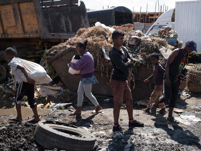 A clean-up operation at a market in Antananarivo on October 10. Picture: AFP/Rijasolo