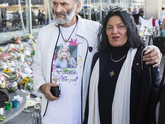 Looking for their daughter ... George and Angela Dyczynski, parents of MH17 victim Fatima Dyczynski arrive at Schipohl airport this morning, and visit the flower memorial outside the airport with a Chaplin.