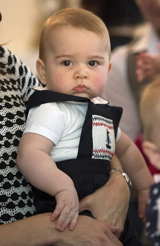 King of the kids ... Prince George is safely snuggled in the arms of his mother, the Duch