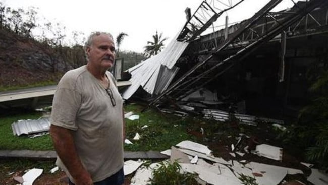 Dave McInerney beside the wreckage of his business at Shute Harbour.