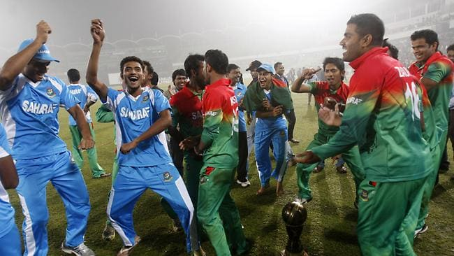 Bangladesh players celebrate after beating the West Indies.