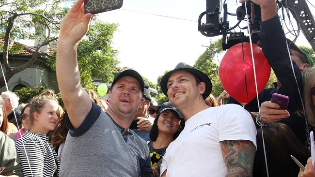 Brad and Dale pose with fans out the front of The Block.