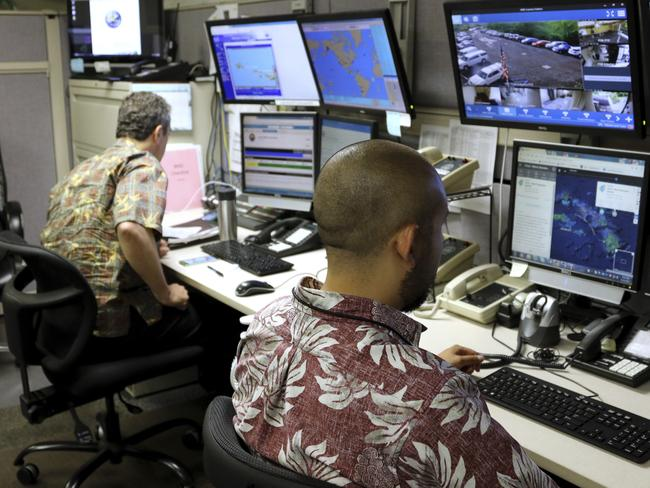 Hawaii Emergency Management Agency officials work at the department's command center in Honolulu. The state is the first to bring back the Cold War-era warning system. Picture: AP
