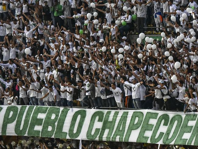 People participate in a tribute to the players of Brazilian team Chapecoense Real.