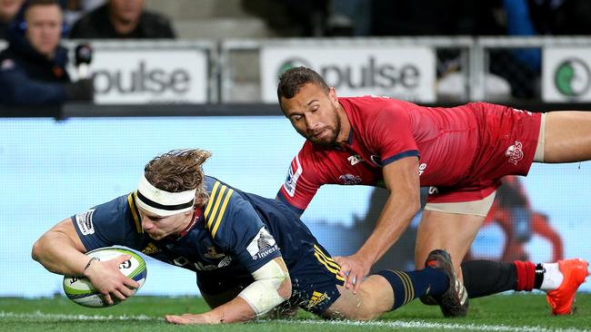 James Lentjes of the Highlanders dives over to score a try in the Kiwi side's routine victory.
