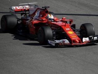 Ferrari driver Sebastian Vettel of Germany steers his car during the qualifying session ahead the Formula One Russian Grand Prix at the 'Sochi Autodrom' circuit, in Sochi, Russia, Saturday, April. 29, 2017. The Russian Formula One Grand Prix will be held on Sunday. (AP Photo/Pavel Golovkin)
