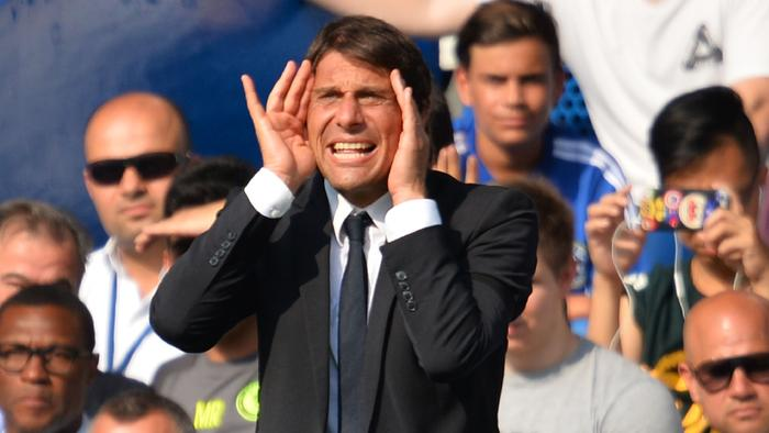 Chelsea's Italian head coach Antonio Conte shouts at his players during the English Premier League football match between Chelsea and Burnley at Stamford Bridge in London on August 27, 2016. / AFP PHOTO / GLYN KIRK / RESTRICTED TO EDITORIAL USE. No use with unauthorized audio, video, data, fixture lists, club/league logos or 'live' services. Online in-match use limited to 75 images, no video emulation. No use in betting, games or single club/league/player publications. /