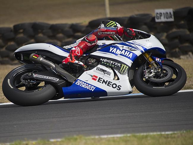 Jorge Lorenzo of Spain and the Yamaha Factory Racing keeps his bike low through a bend at Phillip Island.