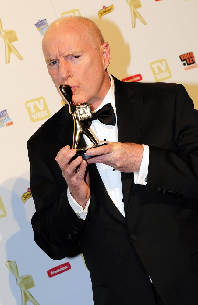 Gold Logie winner ... Ray Meagher kisses his 2010 TV Week Gold Logie.