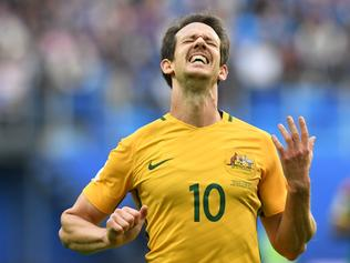 Australia's midfielder Mark Milligan celebrates after scoring with a penalty during the 2017 Confederations Cup group B football match between Cameroon and Australia at the Saint Petersburg Stadium on June 22, 2017. / AFP PHOTO / Kirill KUDRYAVTSEV
