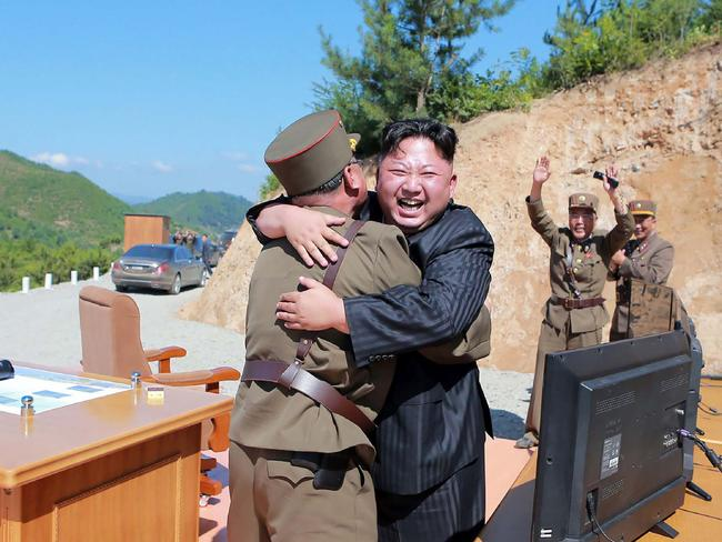 North Korean leader Kim Jong-un celebrates the successful test-fire of the intercontinental ballistic missile Hwasong-14 at an undisclosed location. Picture: AFP