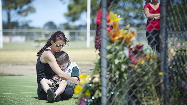 Annie Dawson and her son Liam, 6, visit the Tyabb oval where Luke Batty was mudered. Picture: Eugene Hyland