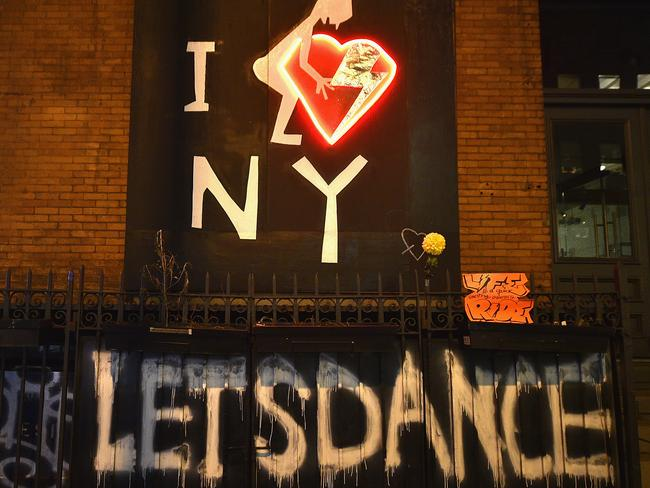 Stirring tributes ... graffiti painted outside David Bowie's New York home. Picture: Getty Images