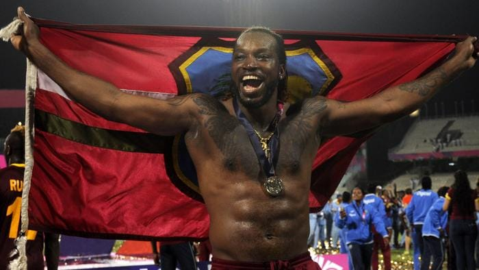 West Indies cricketer Chris Gayle poses as he celebrates after victory in the World T20 cricket tournament final match between England and West Indies at The Eden Gardens Cricket Stadium in Kolkata on April 3, 2016. / AFP PHOTO / ARINDAM DEY