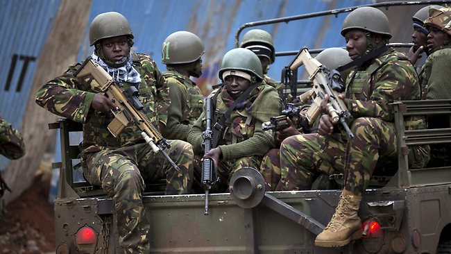 Trucks of soldiers from the Kenya Defense Forces pictured arriving after dawn on Sunday local time outside the Westgate Mall. Picture: AP Photo/Ben Curtis