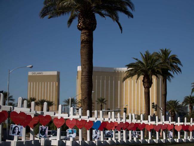 With the Mandalay Bay Resort and Casino in the background (at right), 58 white crosses for the victims of Sunday night's mass shooting stand on the south end of the Las Vegas Strip. Picture: Drew Angerer/Getty Images/AFP
