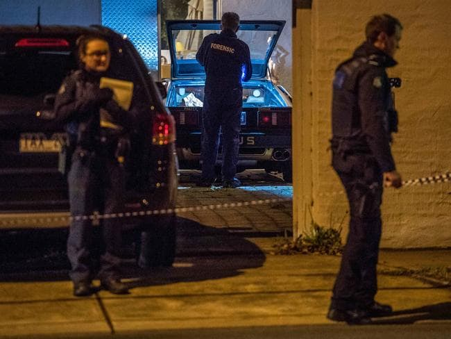 Police search for clues after two people were found dead inside a house in Kew. Picture: Jake Nowakowski
