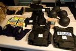 <p>NSW Police Force and the Australian Crime Commission have seized a cache of weapons and prohibited items including a Thompson sub-machine gun, handguns, military assault rifles and ballistic vests, during a raid at Kogarah in Sydney's south today. Pic. Media Police</p>