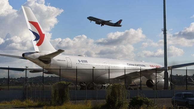 A China Eastern Airbus A330 passenger aircraft, awaits a new left engine at Sydney Airport. Picture: AFP/William West