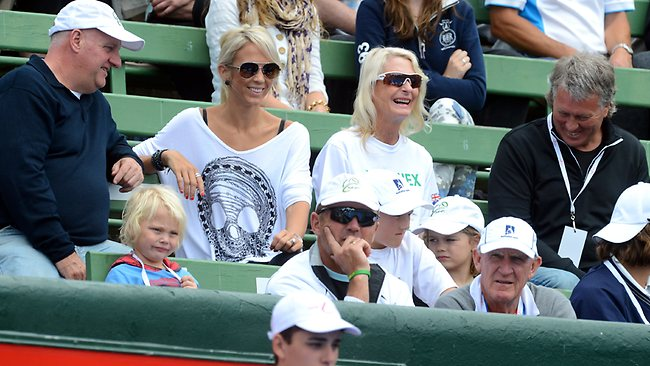 Lleyton Hewitt's family, including wife Bec and son Cruz,4, watch the action at Kooyong. Picture: Wayne Ludbey