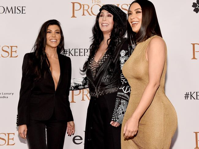 Kourtney and Kim laugh with Cher on the red carpet at The Promise premiere.