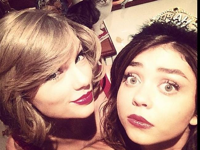 Part of the family ... Modern Family's Sarah Hyland looks afraid as she goes in to celebrate NYE with Taylor Swift.