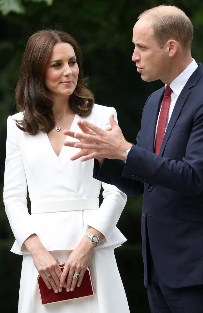 Note Kate's red clutch bag ... and Wills' red tie. Picture: Getty Images