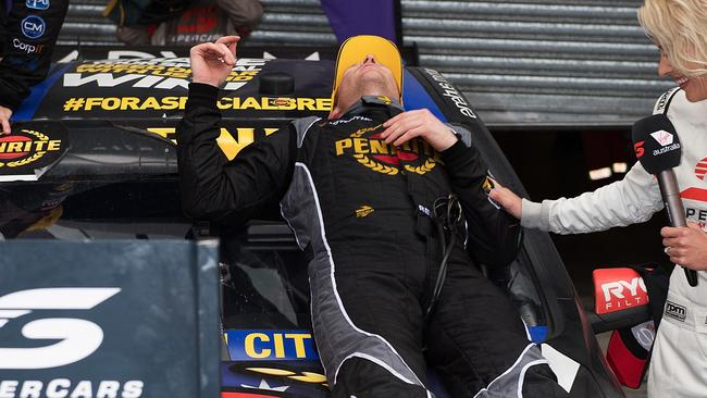 Reynolds celebrates his Bathurst 1000 win by taking a nap on his car. Picture: Getty Images