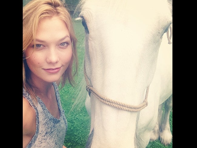 "GIDDY up! Celebrity pony club seems to be all the rage with stars all in a canter over their favourite noble steeds. American model Karlie Kloss, ""I made a friend this morning."" Picture: Instagram"